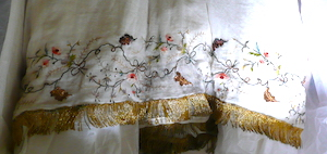hem of embroidered Regency gown